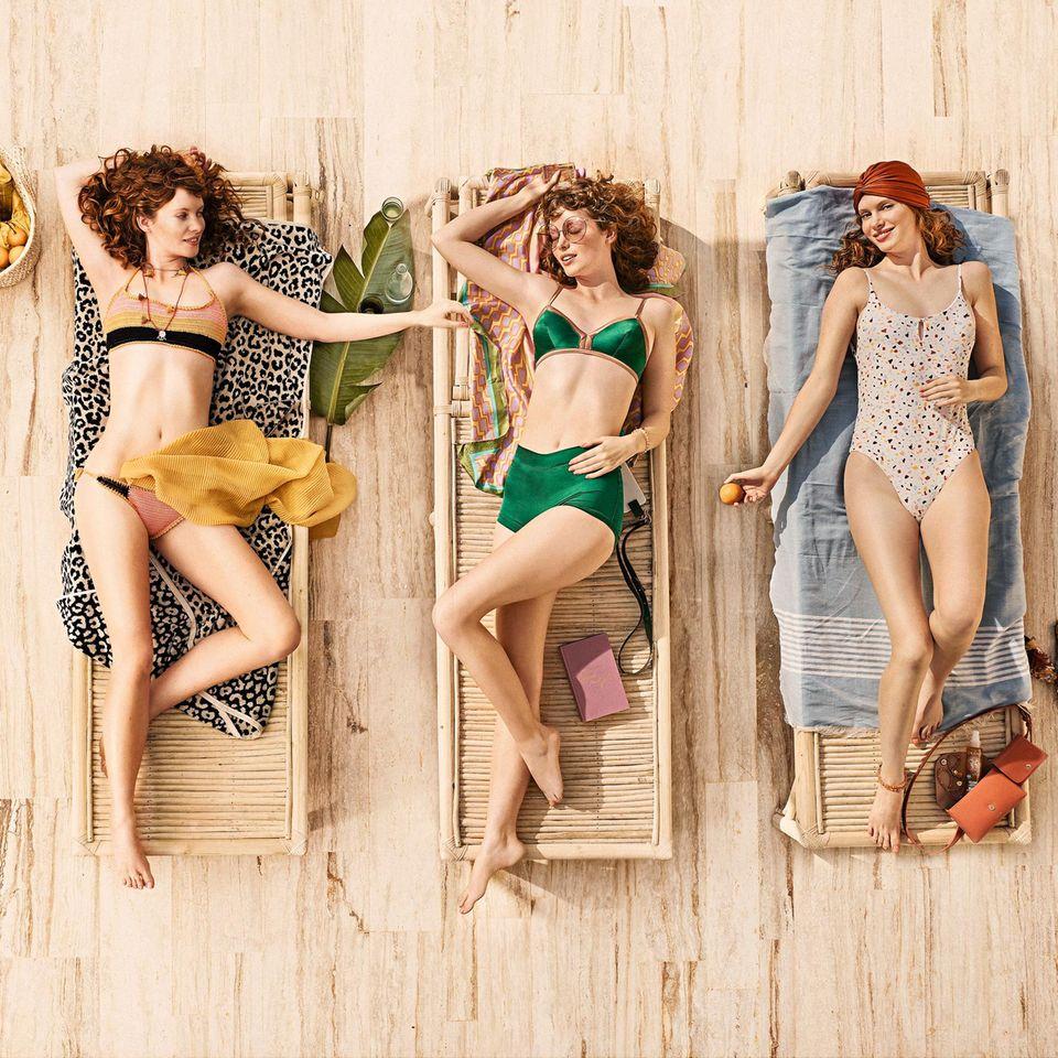 Sonnenschutzmittel: Drei Frauen beim Sonnen