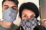 """""""Ein Schutz fürs Leben"""": Mann und Frau mit Masken"""