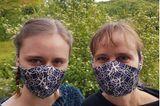 """""""Ein Schutz fürs Leben"""": Frau und Mädchen mit Masken"""