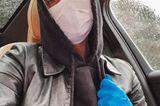 Promis mit Mundschutz: Sophia Thomalla im Auto