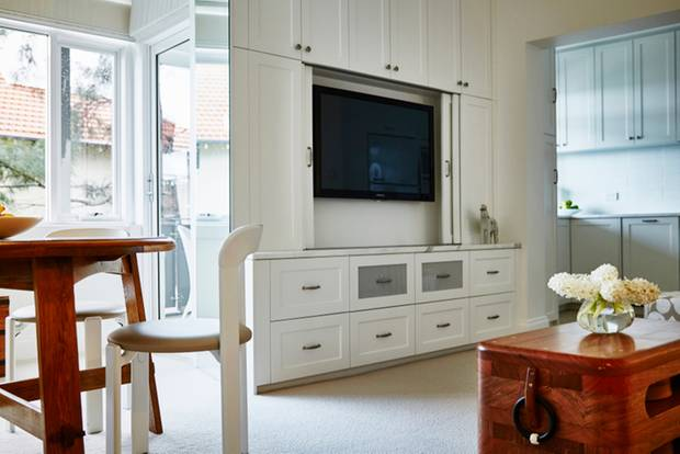 Hide television: living room with wall unit