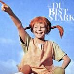 Pippi Langstrumpf lacht und streckt den Arm