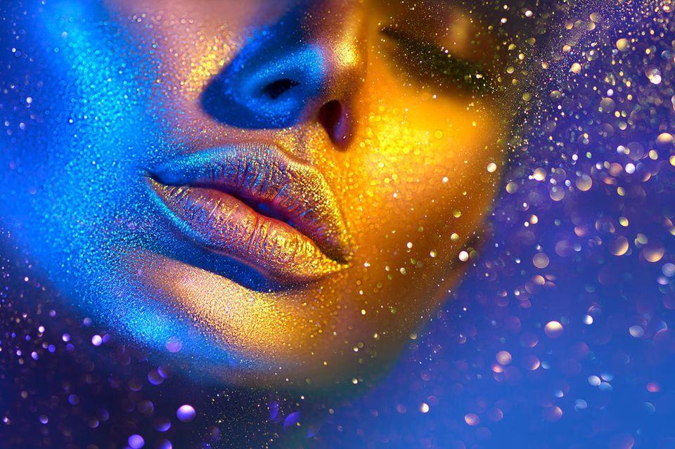 Morgenstund hat Gold im Mund: Gold schimmerndes Gesicht
