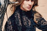 Schwarze Mode: Bluse aus transparentem Polyester mit Punkten