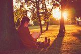 Städtereise: Frau im Park