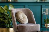 Leseecke einrichten: Sessel mit Kissen
