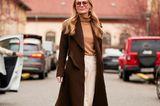 Einen Hauch von 60s versprüht dieser Look dank leicht getönter Sonnenbrilleund lässigen Wollteilen von Cremebeige bis Schokobraun. We looove!