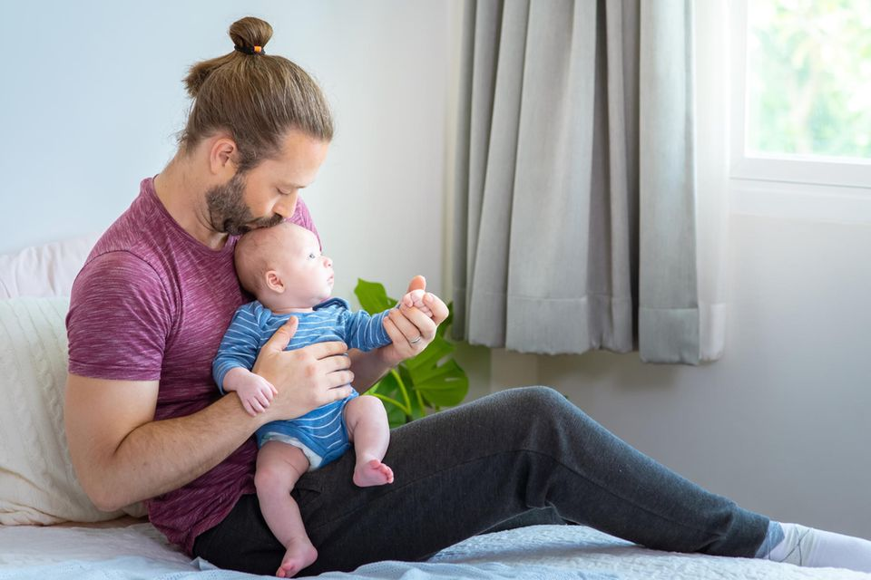 Kommentar: Vater mit Baby