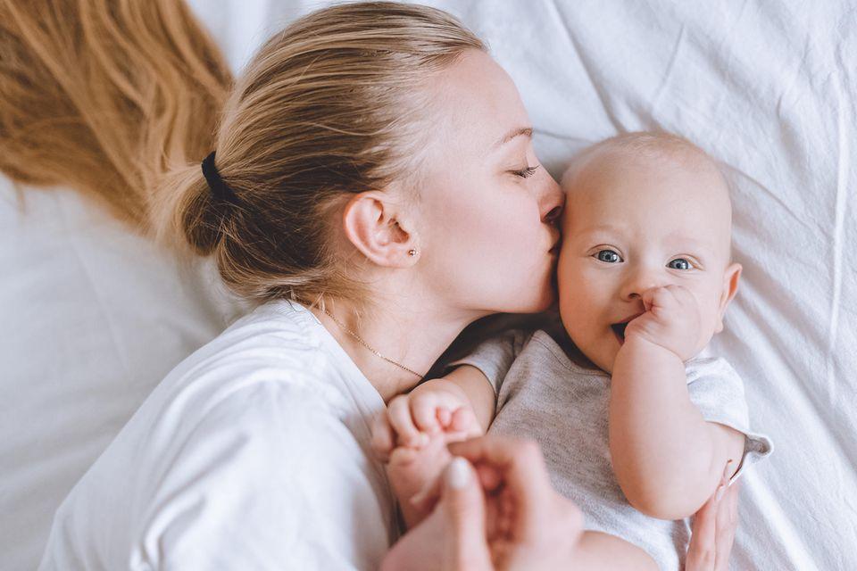In welchem Alter sollte man Kinder kriegen: Mutter mit Baby