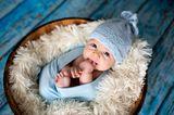 Liebevolle Babynamen: Baby mit blauer Mütze