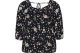 Ein hübscher Ausschnitt am Rückenist ein oft unterschätztes Detail an Blusen oder Shirts. Dieses Oberteil punktet sowohl mit einem Blumenmuster in Schwarz-Weiß als aucheinem zierlichen Bändchen und Cut-Out am Rücken – we love!Von Navabi, kostet ca. 30 Euro.