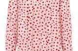 Diese Bluse macht einfach gute Laune. Denn mit ihrem rosa-roten Blumen-Print wertet sie nicht nur im Nu jeden Basic-Look auf, sondern überzeugt auch mit ihren inneren Werten. Das It-Piece besteht aus 100 Prozent Seide und hinterlässt ein wunderbares Gefühl auf der Haut. Von Steffen Schraut, kostet ca. 330 Euro.