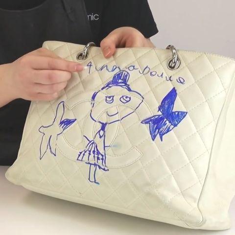 Chaneltasche mit Filzstift bekritzelt