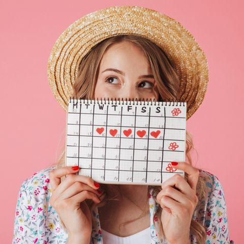 Corona aktuell: Frau mit Zyklus-Kalender