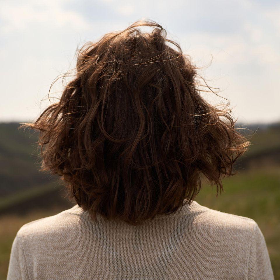 Horoskop: eine Frau von hinten